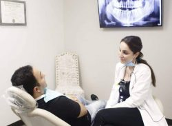 dental hygienist cleaning teeth